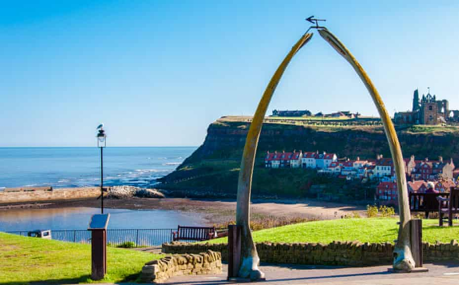 The Whalebone Arch in Whitby, with the abbey in background in North Yorshire, UK