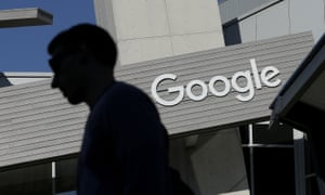 a man walks past a building on the Google campus in Mountain View, California
