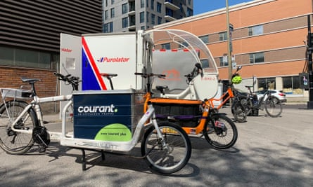 Cargo bikes from companies Purolator and Courant participating in Colibri, Montreal's eco-friendly urban delivery project.