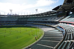 The Round 1 AFL match between the Hawthorn Hawks and the Brisbane Lions is played in an empty stadium, Melbourne,  Australia