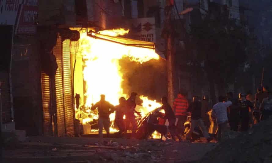 A shop burns during violence in New Delhi, India.
