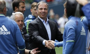 Bruce Arena, center, shakes hands with members of the Seattle Sounders coaching staff before their meeting earlier this month