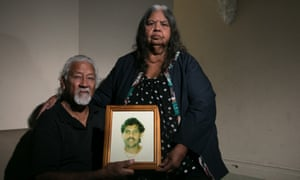 Ted and Helen Russell with a photo of their son Edward, who died in a New South Wales jail in 1999.