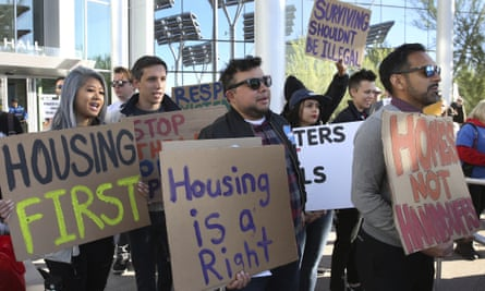 Protesters shout as they hold signs outside Las Vegas City Hall during a protest against the city council's ban on homeless camping on Wednesday, 6 November 2019.