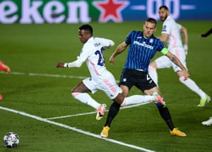 Vinicius Junior of Real Madrid is fouled by Rafael Toloi of Atalanta and the ref points to the spot.