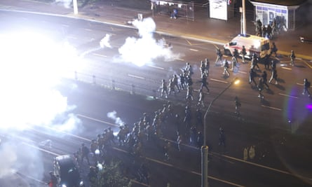 Police in Minsk use flash-bang grenades and rubber bullets to disperse protesters