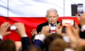Poland's ruling party Law and Justice (PiS) leader Jarosław Kaczyński, gestures as he speaks after the exit poll results are announced in Warsaw, Poland, on 13 October.