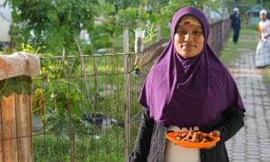 A Rohingya woman, Fatima Khatu, holds tamarind fruits gathered in a refugee camp in Bireuen
