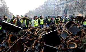 Chairs from cafés are used as a barricade on the Champs-Élysées in Paris