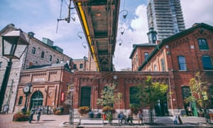 The Distillery District - Toronto, Ontario, Canada. Shoppers stroll its pedestrianised streets.