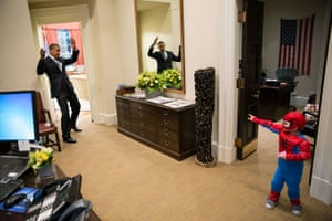 The president pretends to be caught in Spider-Man's web as 3-year-old Nicholas Tamarin catches him outside the Oval Office