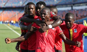 Uganda's Patrick Kaddu celebrates scoring their first goal with teammates.