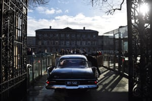 Richard ODonoghue, an independent elected TD from Limerick arrives in a vintage American car reportedly used as part of the cavalcade during the 1963 visit of US President John F Kennedy at the reconvening of the 33rd Dail Eireann following the recent Irish Election