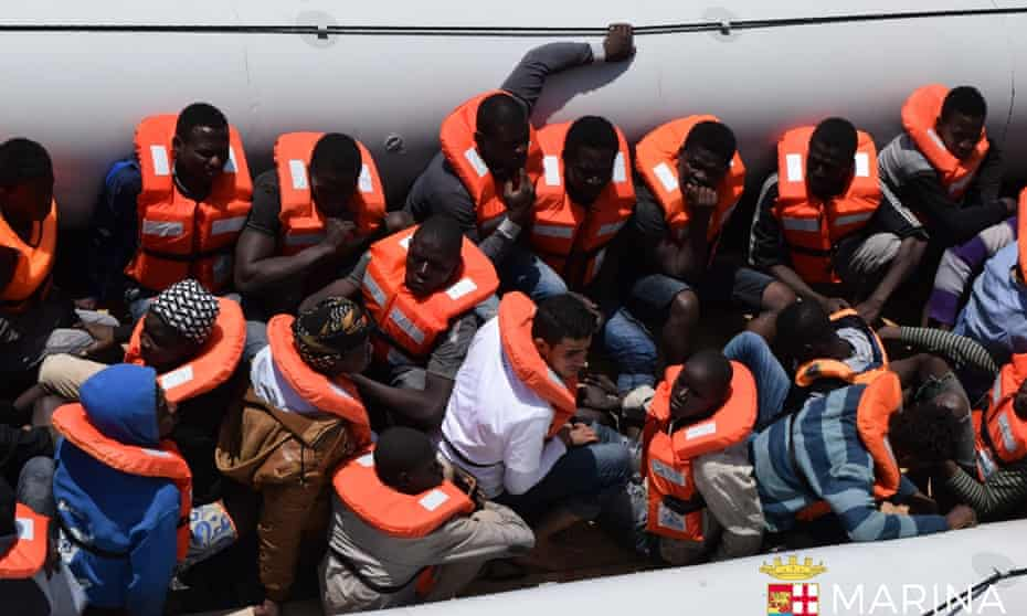 The Italian navy rescues a group of people off the coast of Libya.