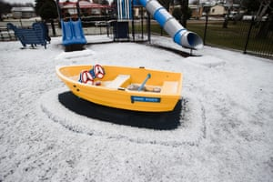 A children's playground is transformed by snow at Adaminaby