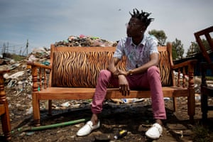 Henry 'Octopizzo' Ohanga, a successful rap artist, on the railway tracks in Kibera