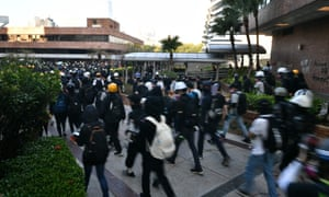 A large group of anti-government protesters try to find safe passage out of Hong Kong Polytechnic University and dodge police in Hung Hom district of Hong Kong on November 18, 2019