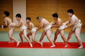 Kumagai, centre, warms up with other boys before training at Komatsuryu sumo club