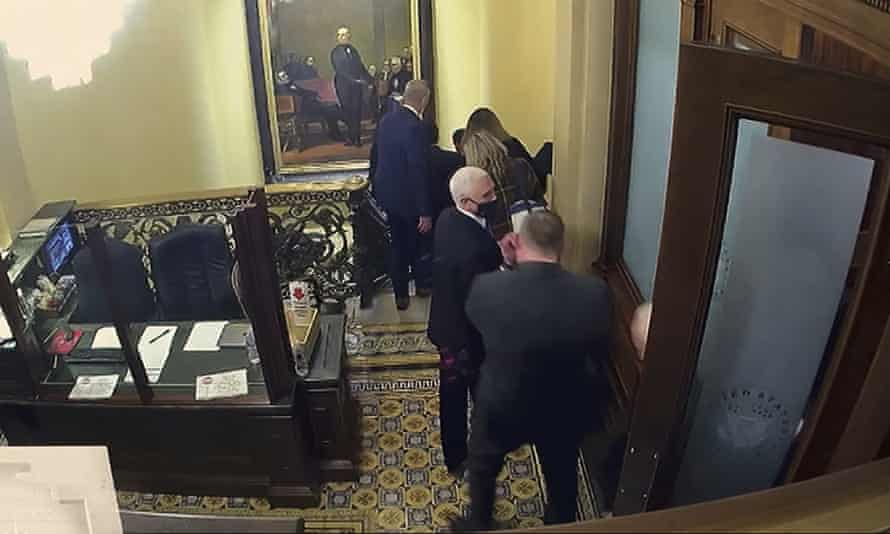 A still from a security video shows Mike Pence being evacuated as rioters breach the US Capitol.