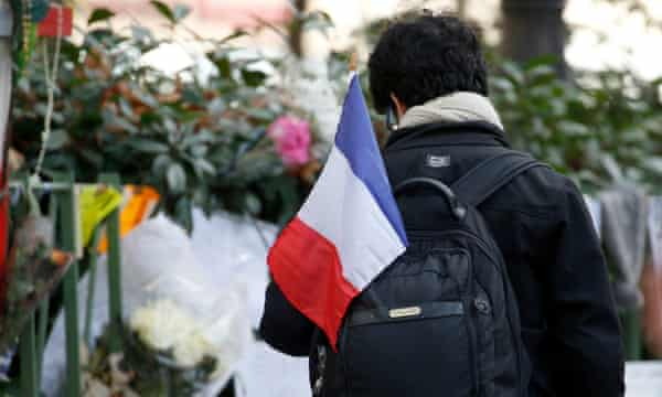 A man with a tricolore outside the Bataclan concert hall in Paris.