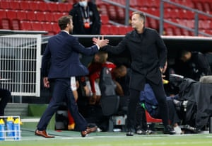 England manager Gareth Southgate with Denmark coach Kasper Hjulmand after the match.