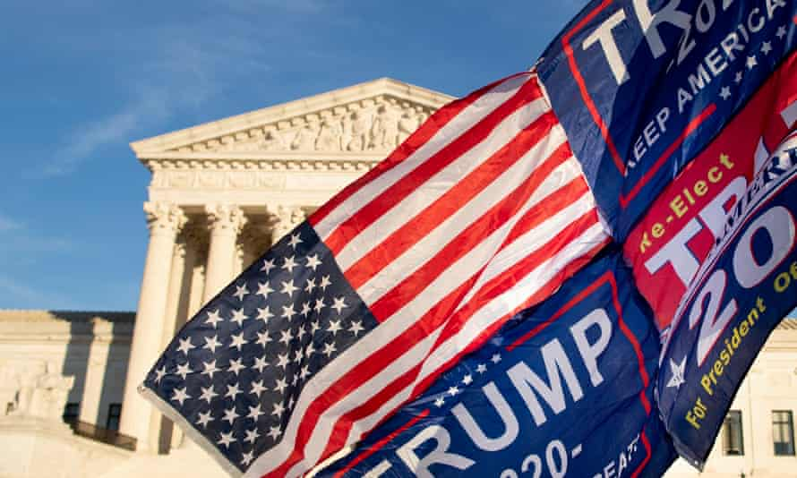 supreme court with trump flag in front of it