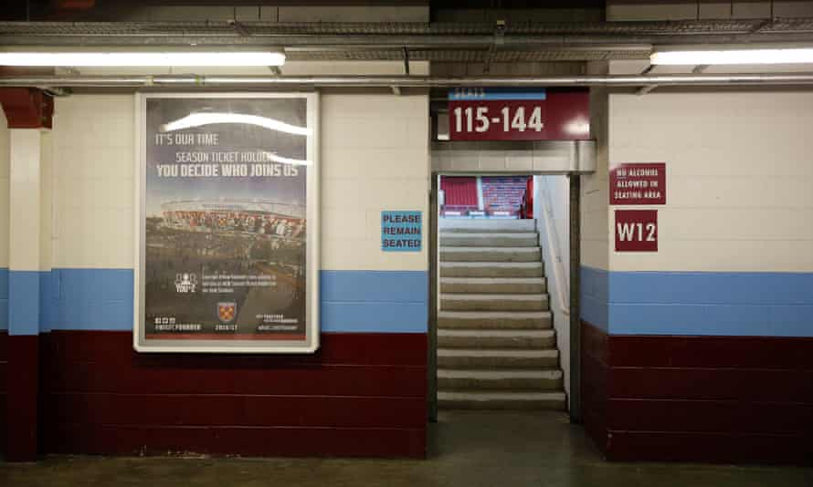 The old and the new: A poster advertising West Ham's new stadium on a wall inside Upton Park which has changed so little in over 100 years.