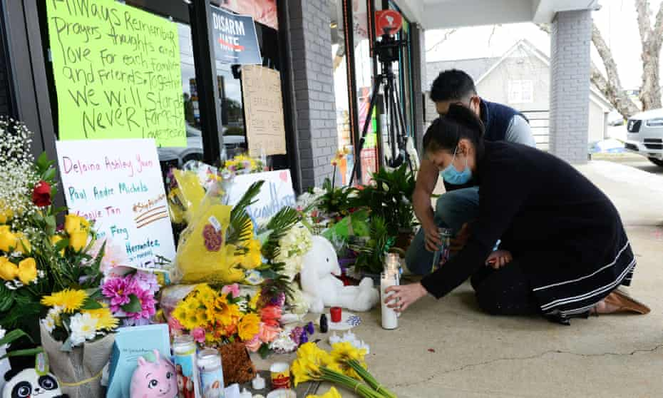 Jami Webb and her fiance, Kevin Chen, light candles outside Young's Asian Massage. Webb is the daughter of Xiaojie Tan, who was killed in the Atlanta shootings.