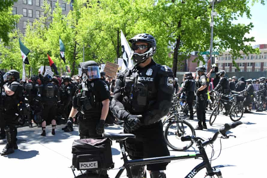 Riot police using bikes in downtown Seattle at the anti-sharia rally last sunday, 11th June 2017