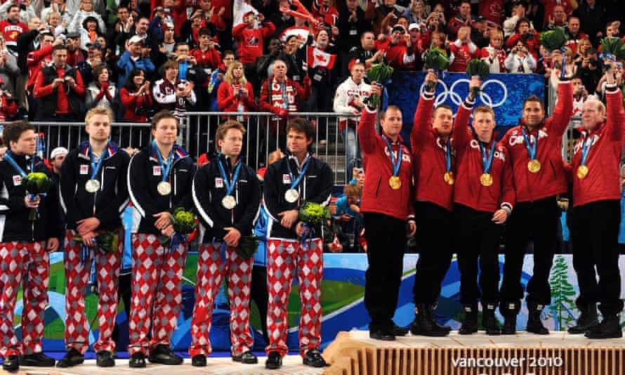 Canada's gold winning team along with silver medalist Norway celebrate on the podium during the Vancouver Winter Olympics