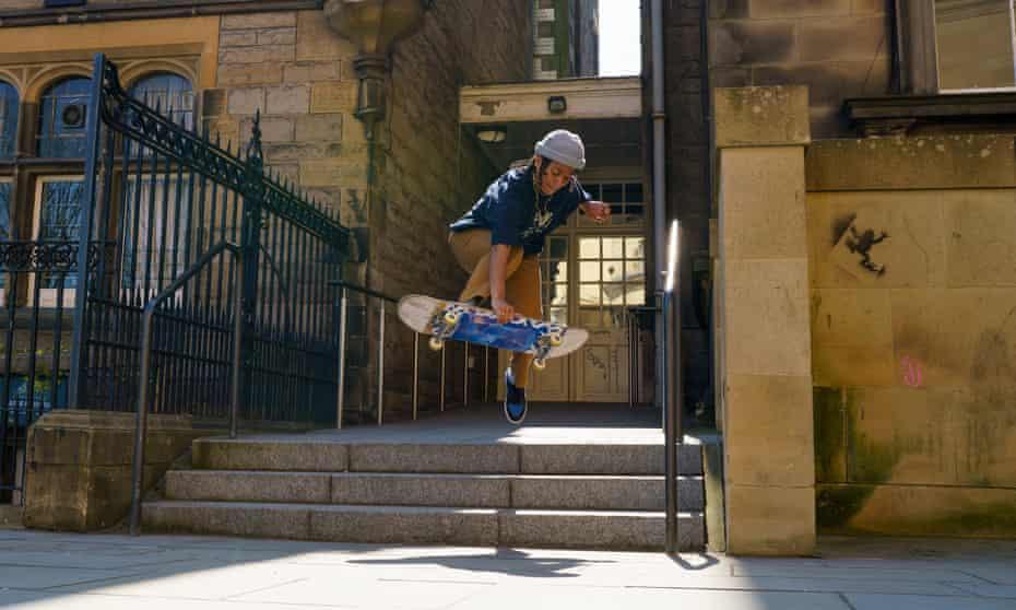 Scottish skateboarder Amy Dunbar pulls off a boneless down steps in central Edinburgh