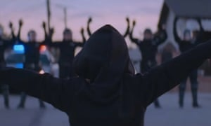 A little boy who had been dancing for helmeted police officers receives their answer, during the video for Beyoncé's new single Formation.