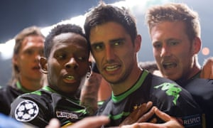 Moenchengladbach's Lars Stindl clebrates scoring the opening goal with teammates Traore and Hahn.