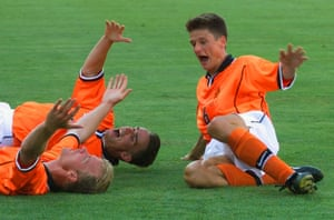 Holland's Dennis Bergkamp, left, is congratulated by teammates Wim Jonk, right, and Marc Overmars after scoring the winning goal against Argentina.