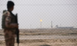 An Iraqi soldier guards an oilfield in Basra