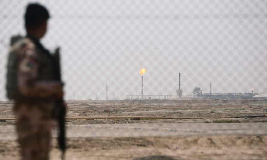 An Iraqi soldier guards an oilfield in Basra