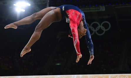 US gymnast Simone Biles competes in the qualifying for the women's Beam event of the Artistic Gymnastics at the Olympic Arena during the Rio 2016 Olympic Games in Rio de Janeiro on August 7, 2016. / AFP PHOTO / Emmanuel DUNANDEMMANUEL DUNAND/AFP/Getty Images