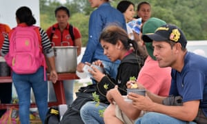 Venezuelans wait at the binational border attention centre in Huaquillas, Ecuador on the border with Peru.