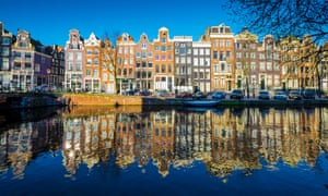 Netherlands, Amsterdam, Traditional old buildings reflected in canal