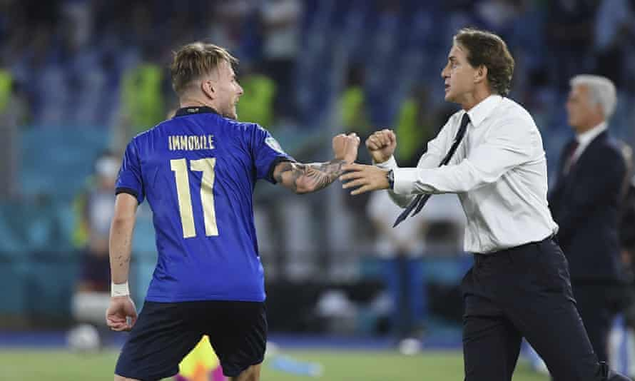 Ciro Immobile celebrates with his coach Roberto Mancini after scoring Italy's third goal against Switzerland