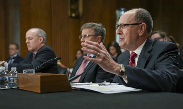 Robert Kehler, right, addresses the Senate foreign relations committee.