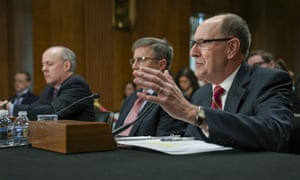 Robert Kehler, right, addresses the Senate foreign relations committee.