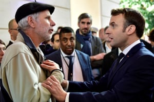 Pau, France: Pierre Coste, a maths teacher, speaks to President Emmanuel Macron about the government's pensions overhaul, at the Beaumont Palace