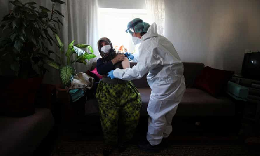 A 76-year old woman receives the second dose of Sinovac Covid-19 vaccine at her home in Deliler village, near Elmadağ, Ankara province.