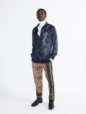 Model wears shirt, £35, asos.com. Roll neck, £22, and trousers, £35, riverisland.com. Loafers, £79.99, zara.com.