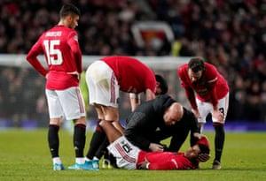 Rashford receives medical attention.
