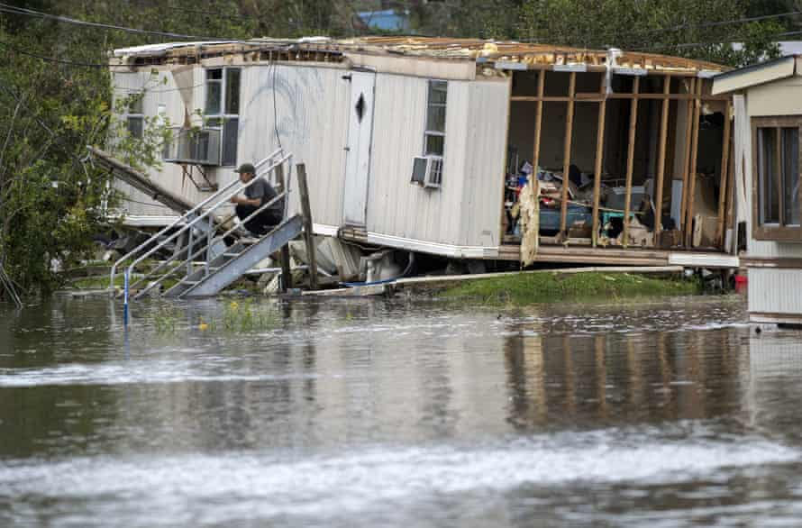 Surrounded by floodwater, a homeowner sits on his front steps after Hurricane Ida destroyed part of the mobile home near LaPlace, near New Orleans, on Monday.