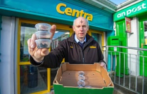 Joe Joyce with takeaway pots of ashes outside his shop in Clonmany, Co Donegal, Ireland