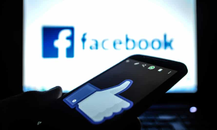 A smartphone and a computer screen with the Facebook logo