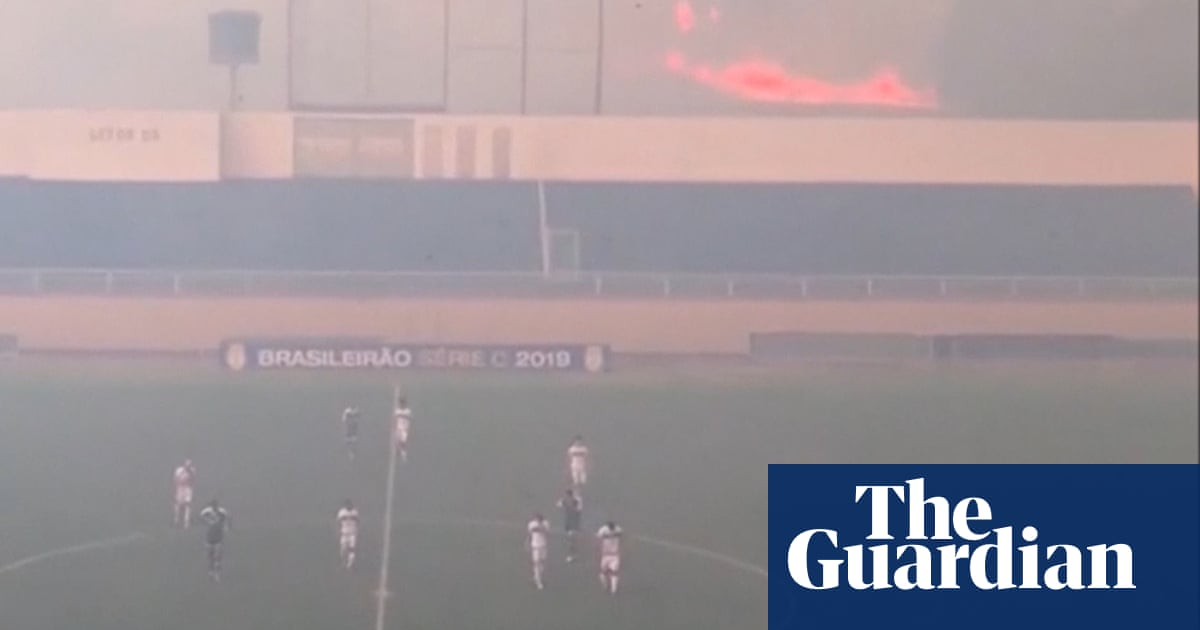 Brazilian football match halted due to nearby wildfire – video
